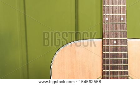 musical background image of acoustic guitar focus on strings with text area very shallow depth of field.