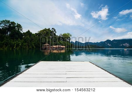 Holiday vacation, white wooden board on lake