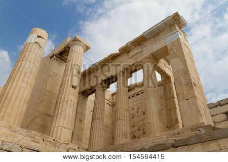 Columns of a temple on the Acropolis of Athens Greece photographed from a low perspective