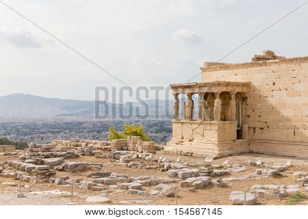 Erechtheum temple on the Acropolis of Athens Greece and the city in the background