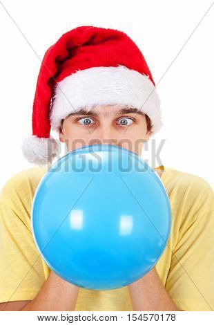 Young Man in Santa Hat inflate a Blue Balloon Isolated on the White Background