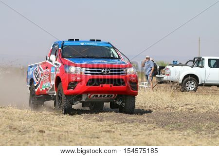 Close-up View Of Speeding Red And Blue Toyota Hilux Single Cab Rally Car