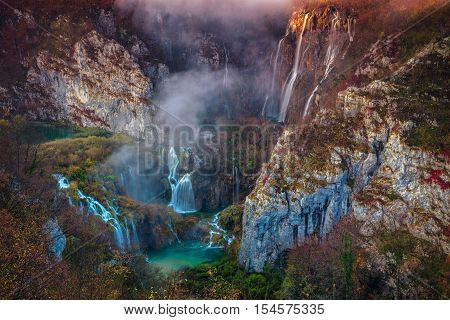 Plitvice Waterfall in autumn. Image of waterfall located in Plitvice national park, Croatia during autumn dawn.