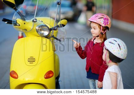 Two Very Curious Little Girls And A Motorcycle