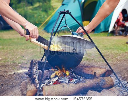 ??? ?ooking food over campfire in hike poster