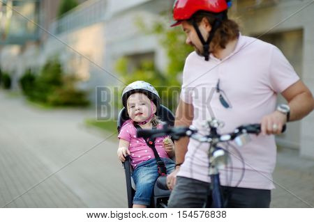 Young Father And His Toddler Girl Riding A Bicycle