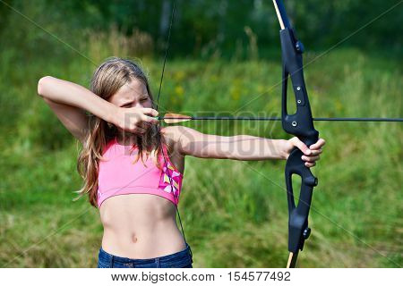 Girl teenager with a bow nock and aims poster