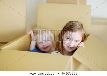 Two Cute Sisters Moving In Her New Home