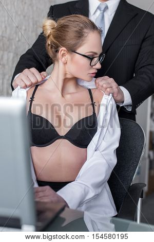 Boss undressing blonde secretary lover in office