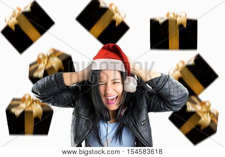 young woman screaming with rain gifts at christmas with santa hat
