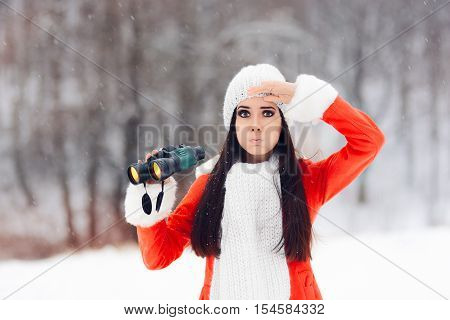Surprised Winter Woman with Binoculars Looking for Christmas
