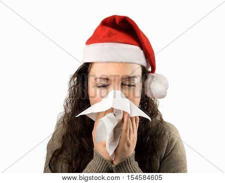 sneezing woman sick blowing nose with santa hat and white background