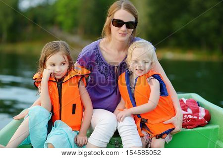 Young Mother And Her Two Daughters On A Boat