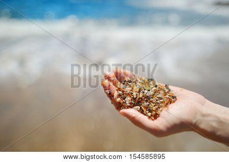 Sand Of Glass Beach Near Port Allen Town On Kauai