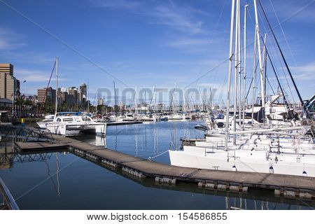Yachts Moored At Wilsons Wharf Against City Skyline