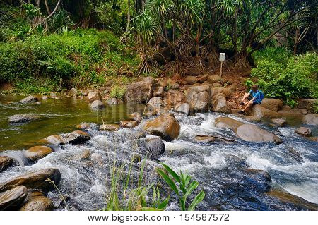 Small tropical river or stream a visitor must cross to get to Hanakapiai beach of Kalalau trail Kauai Hawaii