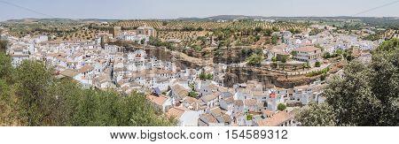 Panoramic view of Setenil de las Bodegas Cadiz Spain. Street with dwellings built into rock overhangs above Rio Trejo.