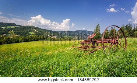 Red Rake In A Field In The Mountains