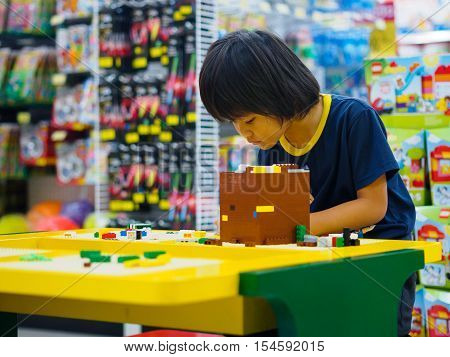 Hat Yai, Songkhla, Thailand - October 3, 2016 : Child plays lego blocks at Lego shop in CentralFestival Hat Yai