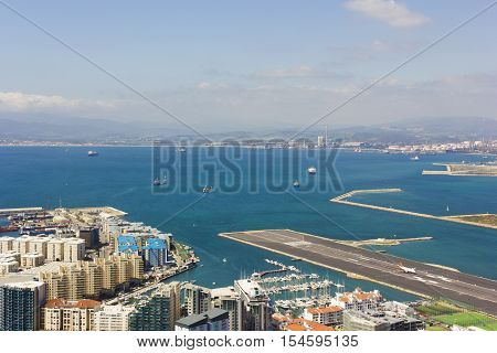 Aerial view of the port city and Bay of Gibraltar located at the southern end of the Iberian Peninsula. Taken from the Great Siege Tunnels at the top of the Rock.