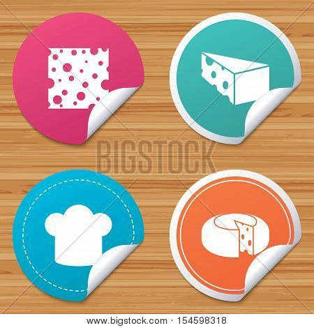 Round stickers or website banners. Cheese icons. Round cheese wheel sign. Sliced food with chief hat symbols. Circle badges with bended corner. Vector