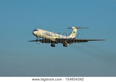 Borispol Ukraine - September 17 2011: Ukraine Government Ilyushin Il-62M passenger plane is landing against blue sky on sunset