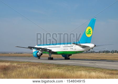 Simferopol Ukraine - September 13 2010: Uzbekistan Airways Boeing 757 taxiing along the taxiway after landing in the airport