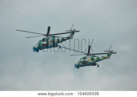 Zhitomir Ukraine - September 29 2010: A pair of Ukrainian Army Mi-24 attack helicopters in flight during military trainings in bad weather conditions