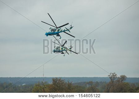Zhitomir Ukraine - September 29 2010: A pair of Ukrainian Army Mi-24 attack helicopters in flight during military trainings making right turn