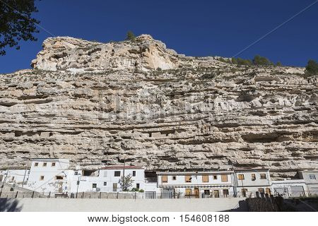 Alcala del Jucar Spain - October 29 2016: Cave House in the mountains of limestone next to the banks of the river Jucar take in Alcala of the Jucar Albacete province Spain