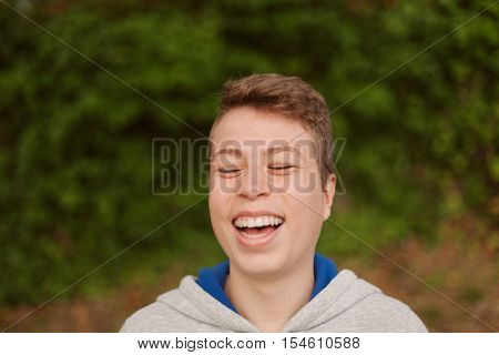 Cool teenager with fifty years old outside laughing