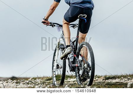 closeup of rear wheel sports bike. race mountainbike in mountains