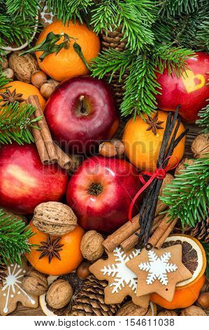 Christmas food with decoration. Fruits nuts spices and cookies
