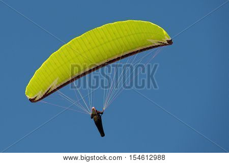Paragliding in the blue sky,extreme paragliding man