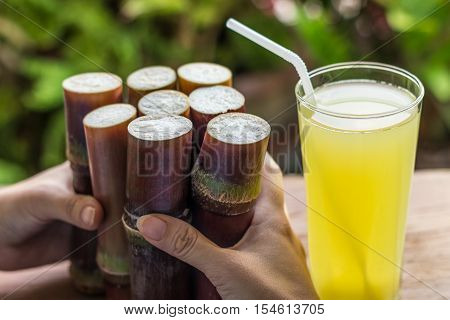Sugarcane Fresh Juice For Healthy Eating, Fresh Food For Dieting And People Concept - Close Up Of Wo