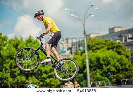 young boy is jumping with his BMX Bike at the skate park