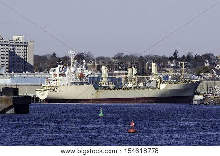 New Bedford Massachusetts USA - November 29 2014: Cargo ship riding high dockside in New Bedford Massachusetts
