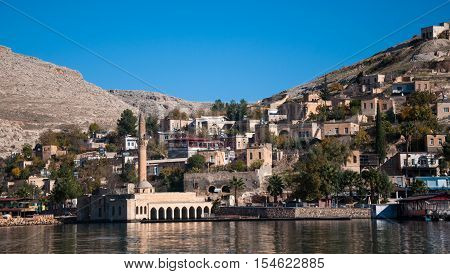 Gaziantep, Turkey - December 08, 2014: Minaret of the mosque in the water in village near Halfeti