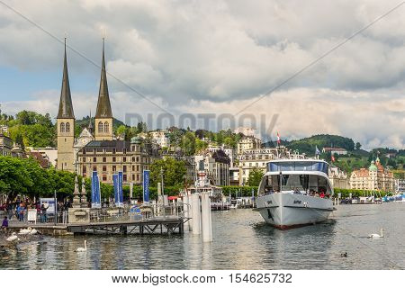 Lucerne Switzerland - May 24 2016: The Church of St. Leodegar with cityscape and Lake Lucerne Switzerland. Lucerne is a city in central Switzerland it is the capital of the Swiss Canton of Lucerne.