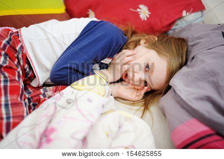 Little Preschooler Girl In Bed On Morning