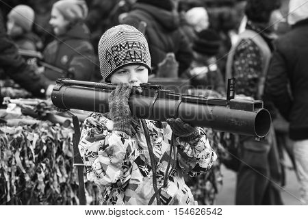 Dneprodzerzhinsk Ukraine - October 15 2016: child holding anti-tank rocket propelled grenade launcher
