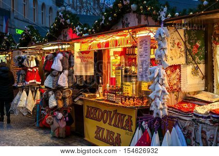 PRAGUE, CZECH REPUBLIC - DECEMBER 11, 2015: Kiosks offering souvenirs and food during Christmas market taking place each year on December. It is popular destination with tourists visiting Prague.