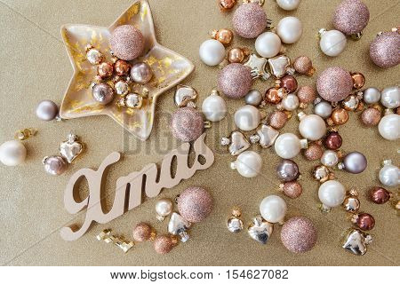 Shiny and glittery christmas decoration on a golden background