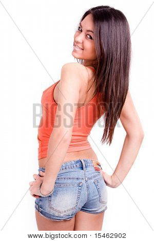 young pretty woman smiling, looking over shoulder