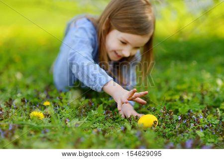 Adorable Little Girl Hunting For An Egg On Easter