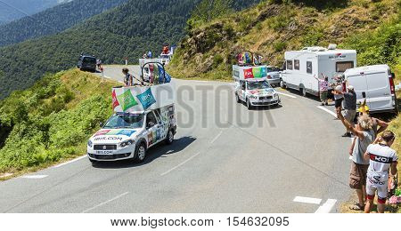 Col D'AspinFrance- July 15 2015: Ibis Hotels Caravan during the passing of the Publicity Caravan on the Col d'Aspin in Pyerenees Mountains in the stage 11 of Le Tour de France 2015. Ibis is an international chain of economic hotels.