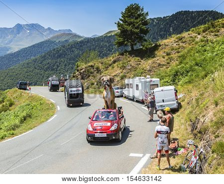 Col D'AspinFrance- July 15 2015: Kleber Caravan during the passing of the Publicity Caravan on the Col d'Aspin in Pyerenees Mountains in the stage 11 of Le Tour de France 2015. Kleber is a famous European company which products a wide range of tires.