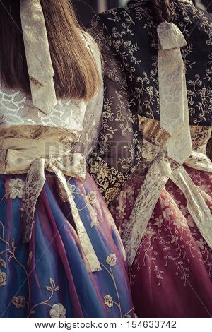 Two Korean Girls dressed in traditional dress