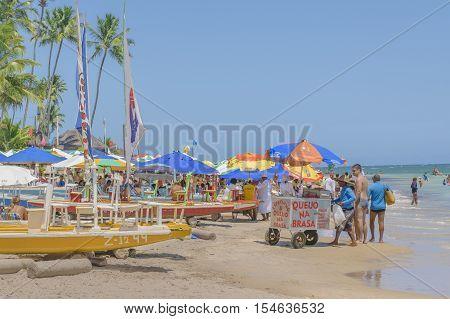 PORTO GALINHAS, BRAZIL, JANUARY - 2016 - Crowded tropical beach in Porto Galinhas Pernambuco Brazil