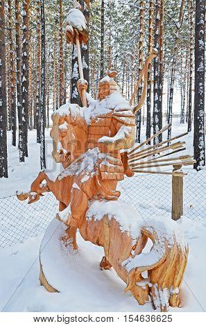 Irkutsk Region,russia-jan, 03 2015: Hercules On Horseback. Park Of Wooden Sculptures In Savvateevka